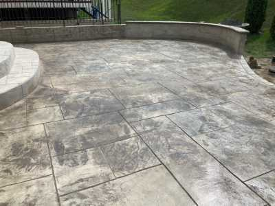 stamped concrete patio with caps