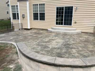 stamped concrete patio with closeup on caps